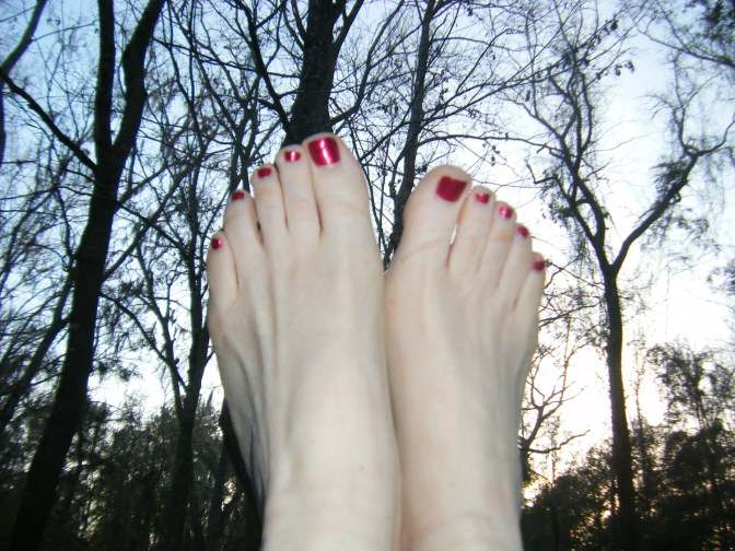 My too-pale feet with their beautiful painted toenails emerged from their shoes to become one with the winter sky... just to illustrate how silly a pedicure in winter could be, except for the lessons it teaches...