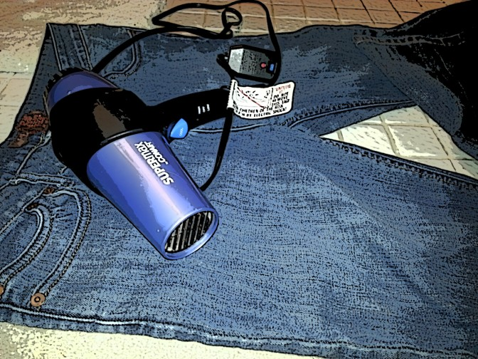 Photo illustration because clearly this is not the black blow dryer we share nor is it the jeans we do not share.