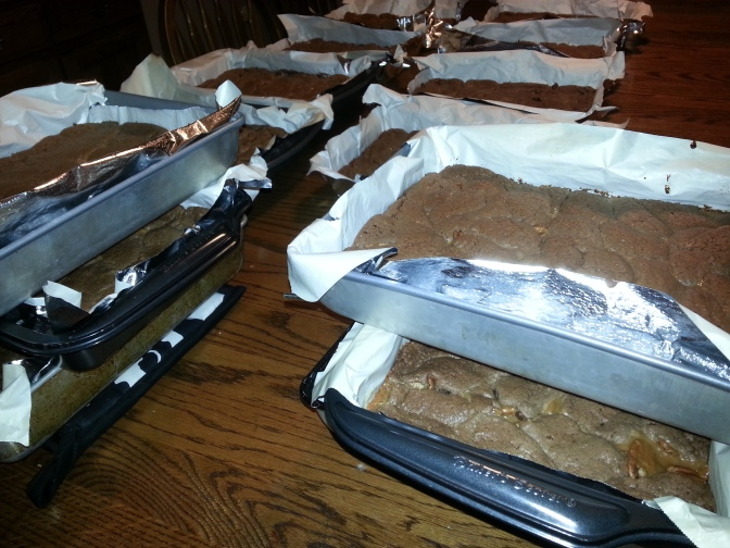 The parade of caramel brownies, cooling comfortably on our dining room table.