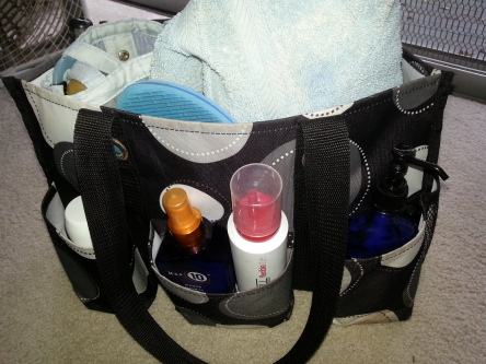 My Thirty-One Gifts utility tote has a place for everything. I put my shower bag, towel, robe, and flipflops in the bag itself and other toiletries in the outside pockets.