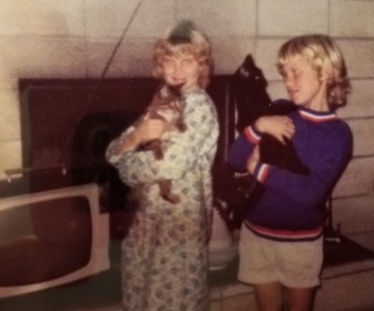 Trish and I with our first cats. She had Kiggy, a male Tabby who ran away in his prime. I held Midnight, who birthed loads of kittens in her lifetime.