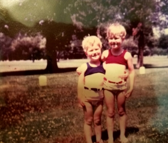 "We were the ""little girls"" of the family, and my mother dressed us alike. I usually had blue; Trish wore red. I'm sporting a diaper under that swimsuit."