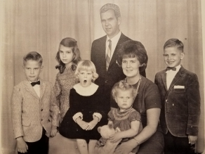 The famous family photo. Apparently, Trish found it to be quite dull.